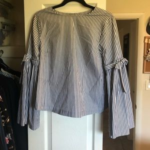 Strip bell sleeve top with button down back